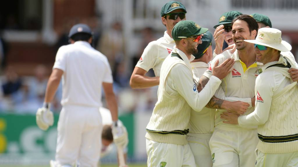 Australia players celebrate the wicket of Alastair Cook