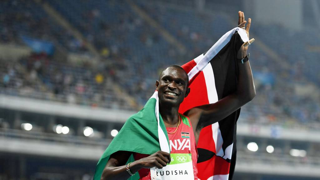 David Rudisha of Kenya celebrates with the flag of Kenya after winning the gold medal in the men's 800m final at the Rio 2016 Olympic Games