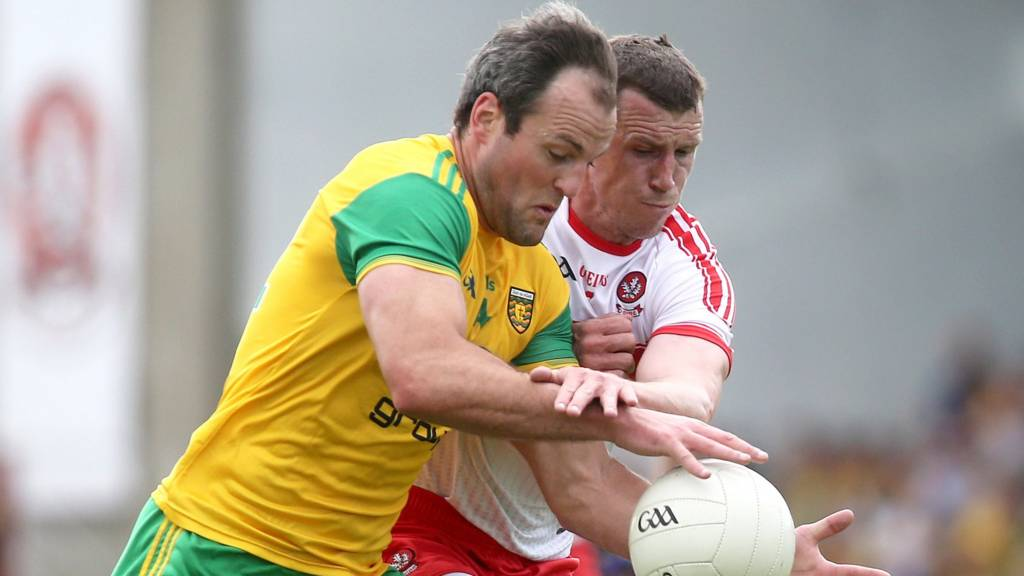 Donegal's Michael Murphy battles with Derry's Michael Bateson at Celtic Park