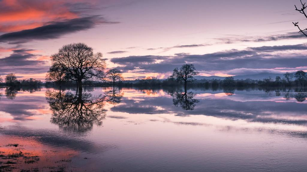 Sunset over Malvern Hills reflecting in flooded fields just off river Severn by New Bridge In Worcester