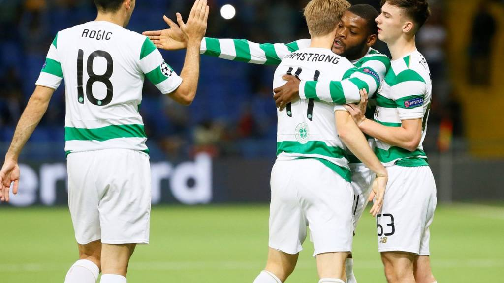 Celtic players celebrate clinching their place in the Champions League group stage