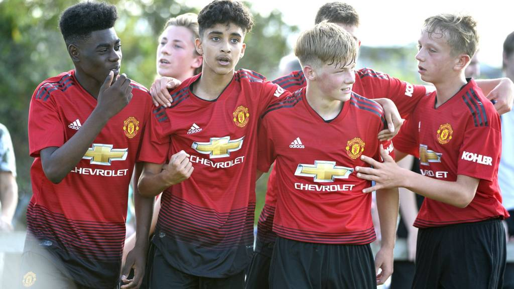 Manchester United players celebrate scoring against Club NI