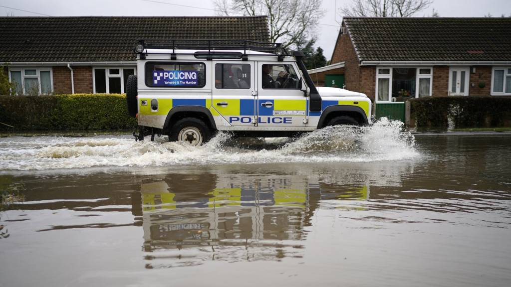 Police vehicle in flood