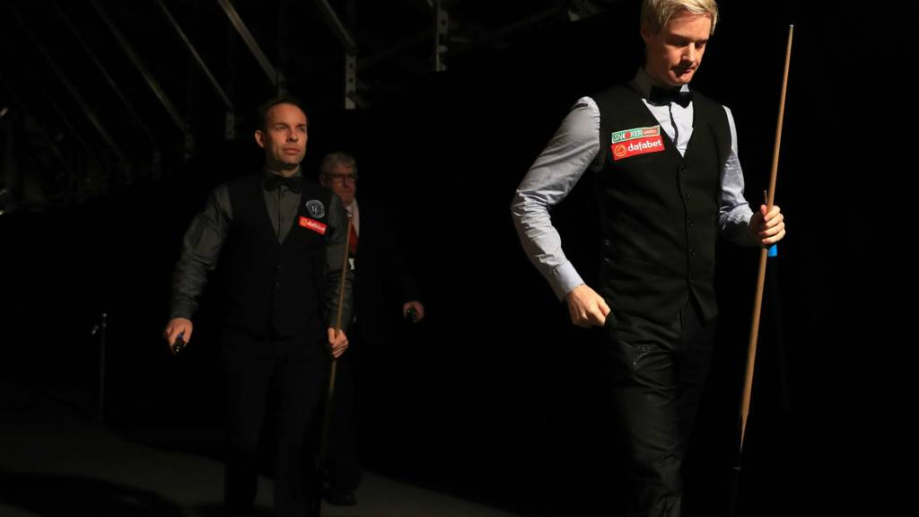 Neil Robertson and Ali Carter walk out