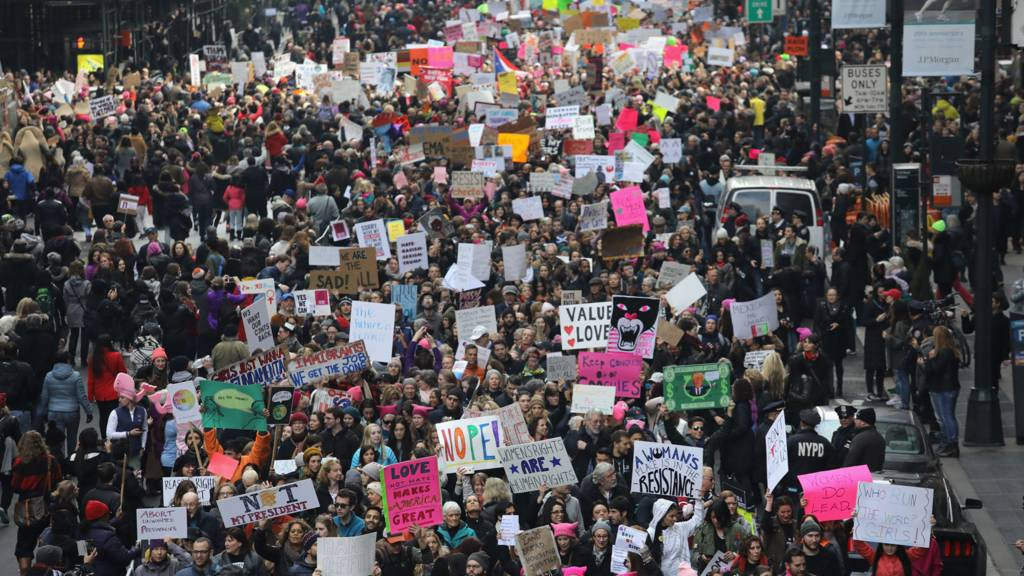 Thousands of people march on 42nd street in New York City