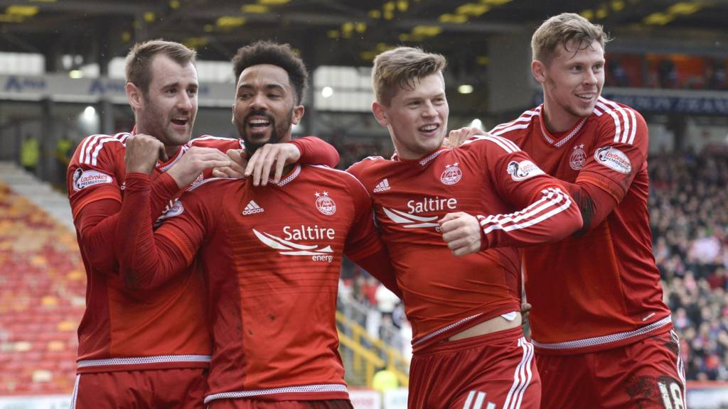Aberdeen celebrate Shay Logan's winner