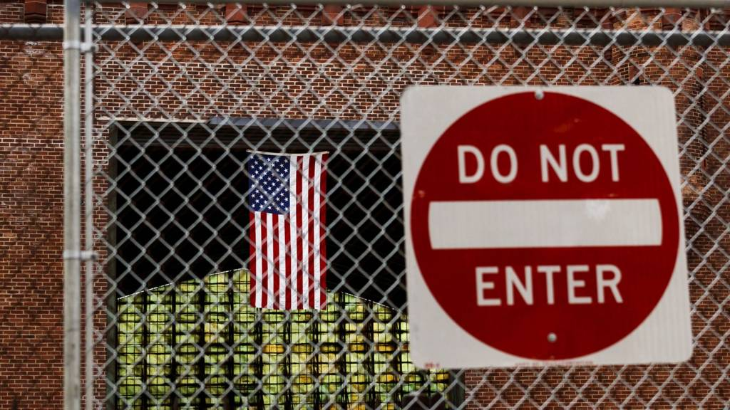 An American flag and a do not enter sign at the Kingsbridge Armory in the Bronx, New York, USA, on 21 April 2020