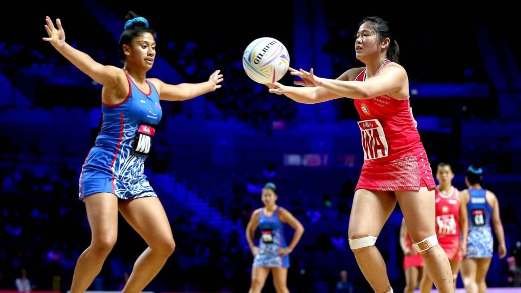 Samoa's Afi Lafaiali'i-Sapolu (left) and Singapore's Kimberly Lim