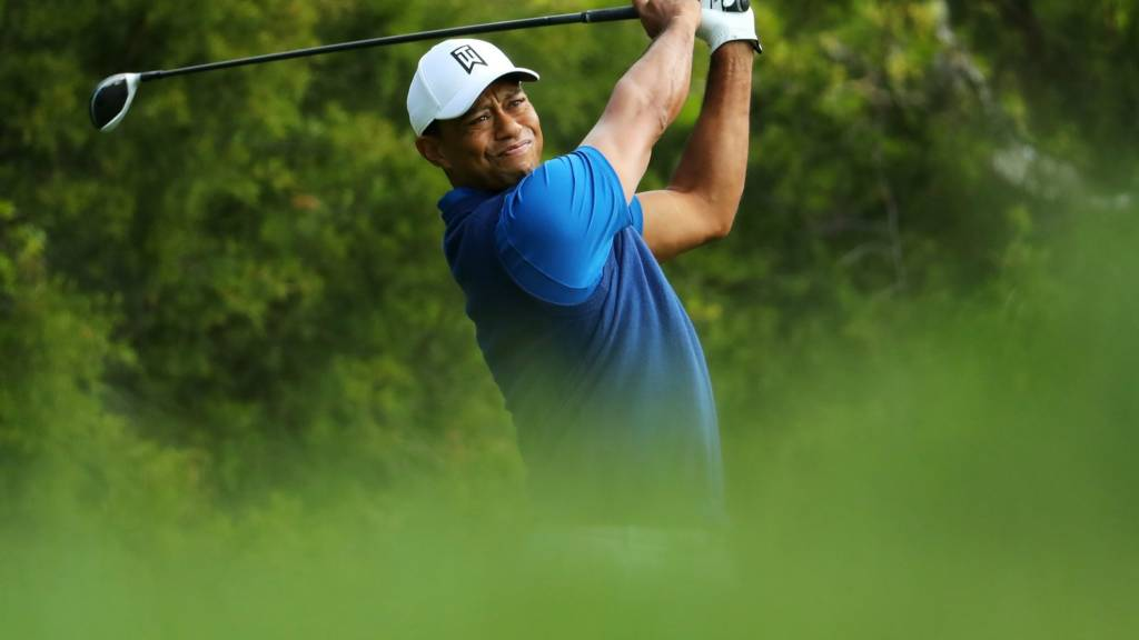 Tiger Woods takes a tee shot in the opening round of the 2019 US PGA Championship