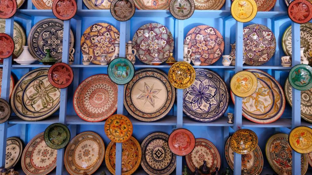 Colourful plates are displayed at a pottery store in Marrakesh, Morocco