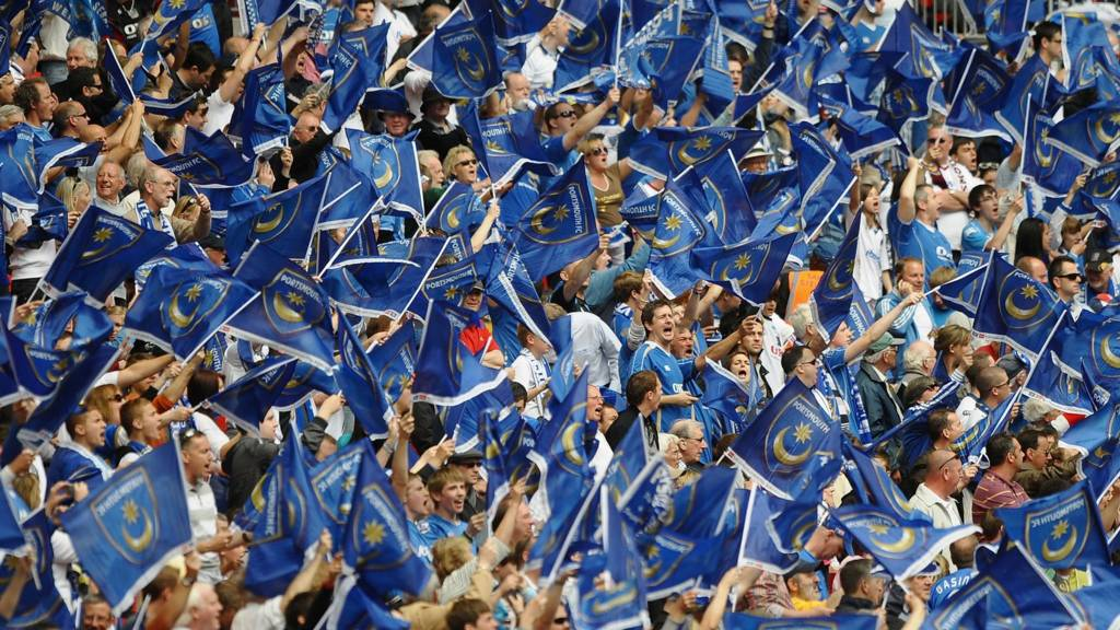 Portsmouth fans wave flags