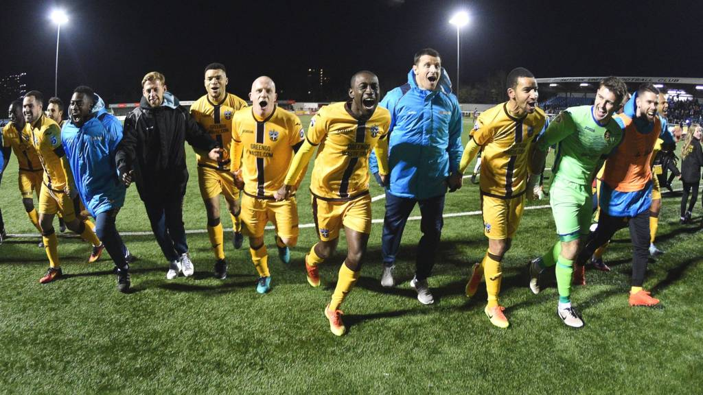 Sutton players celebrate