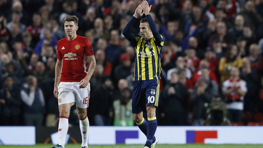 Robin van Persie celebrates scoring for Fenerbahce at Old Trafford