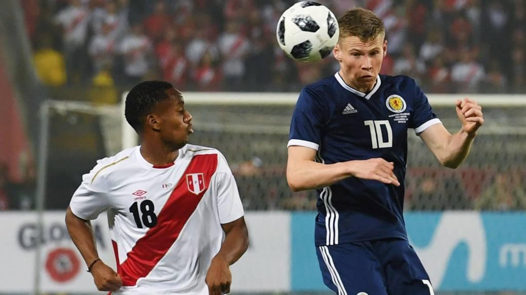 Peru's Andre Carrillo and Scotland's Scott McTominay