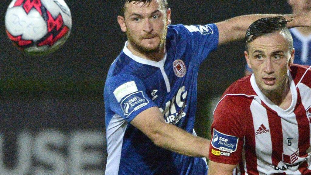 Kevin Toner of St Pat's challenges Derry midfielder Aaron McEneff