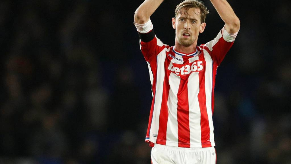 Peter Crouch applauds