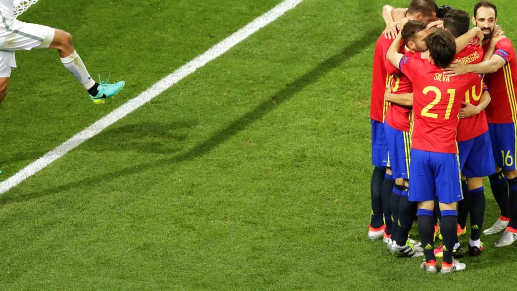 Spain celebrate their third goal