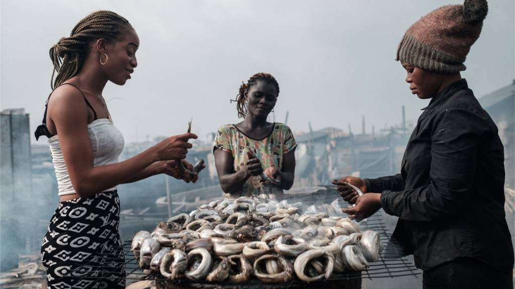 Women smoke fish in Port Harcourt