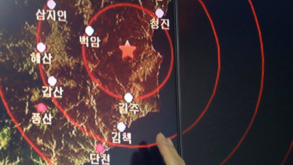 An official of the Earthquake and Volcano of the Korea Monitoring Division points at the epicenter of seismic waves in North Korea, in Seoul, South Korea, Friday, Sept. 9, 2016.