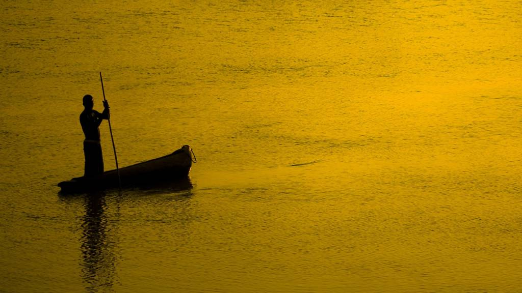 Man in boat silhouetted