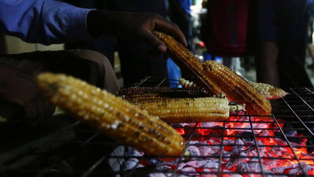 Maize being cooked over coals in Zimbabwe - November 2016