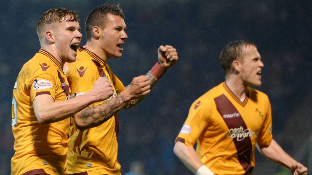 Motherwell celebrate their equaliser through Marvin Johnson (centre)