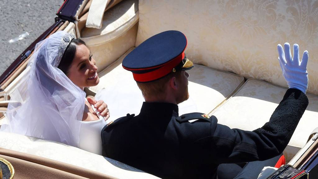 Prince Harry, Duke of Sussex and Meghan, Duchess of Sussex in an open-top carriage, tour Windsor