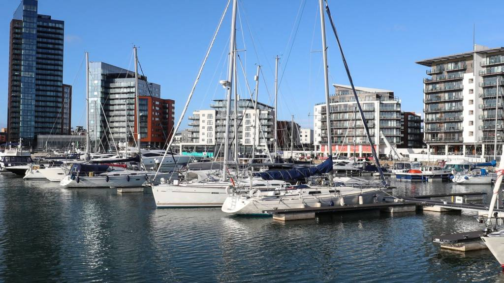 Yachts and modern tower blocks in Southampton