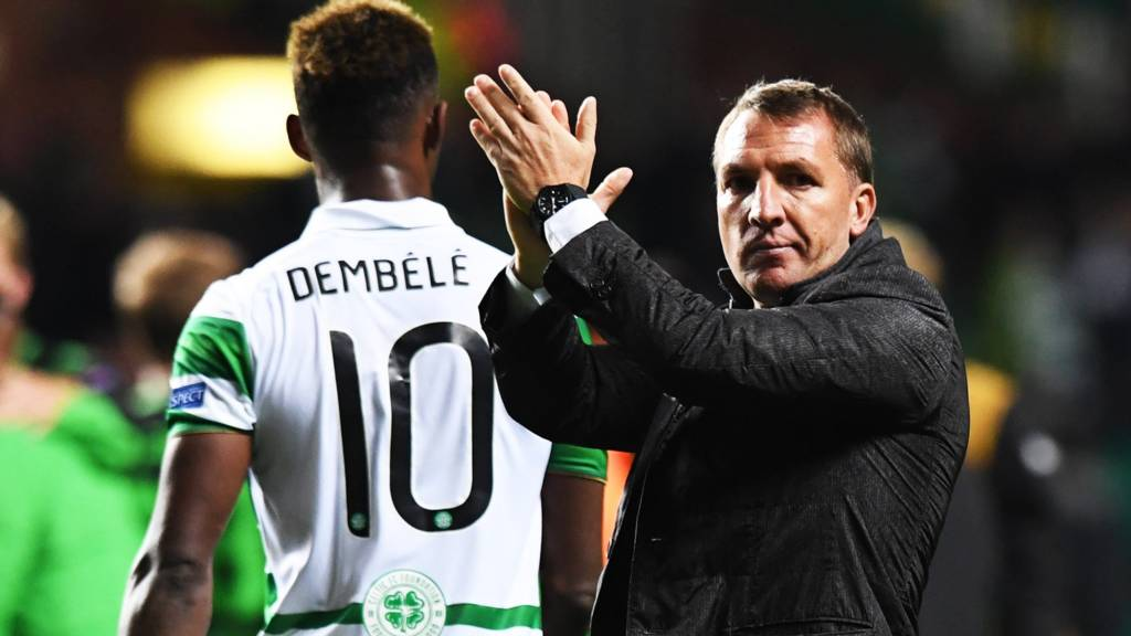 Manager Brendan Rodgers salutes the Celtic fans