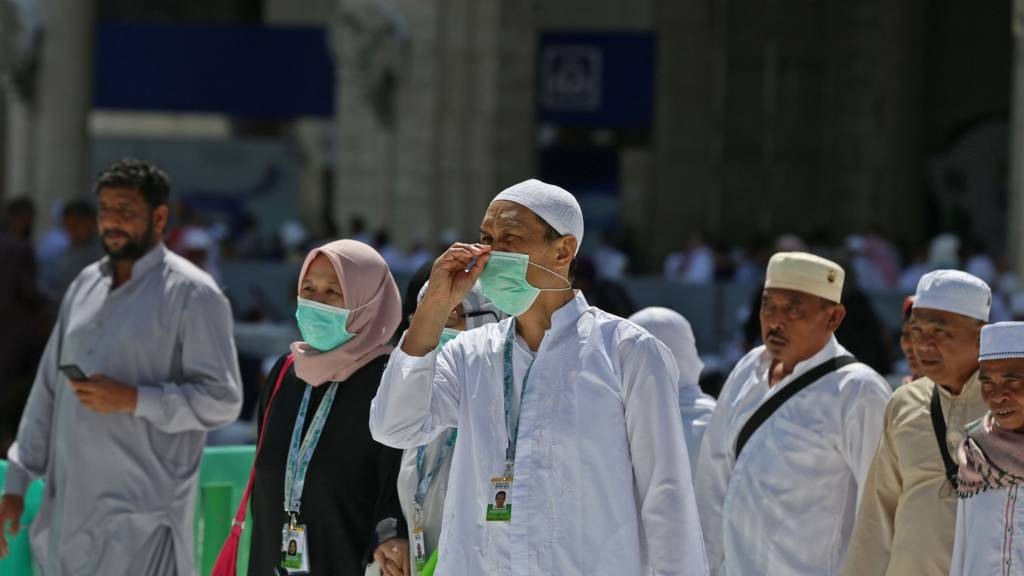 Pilgrim in Mecca wearing face masks