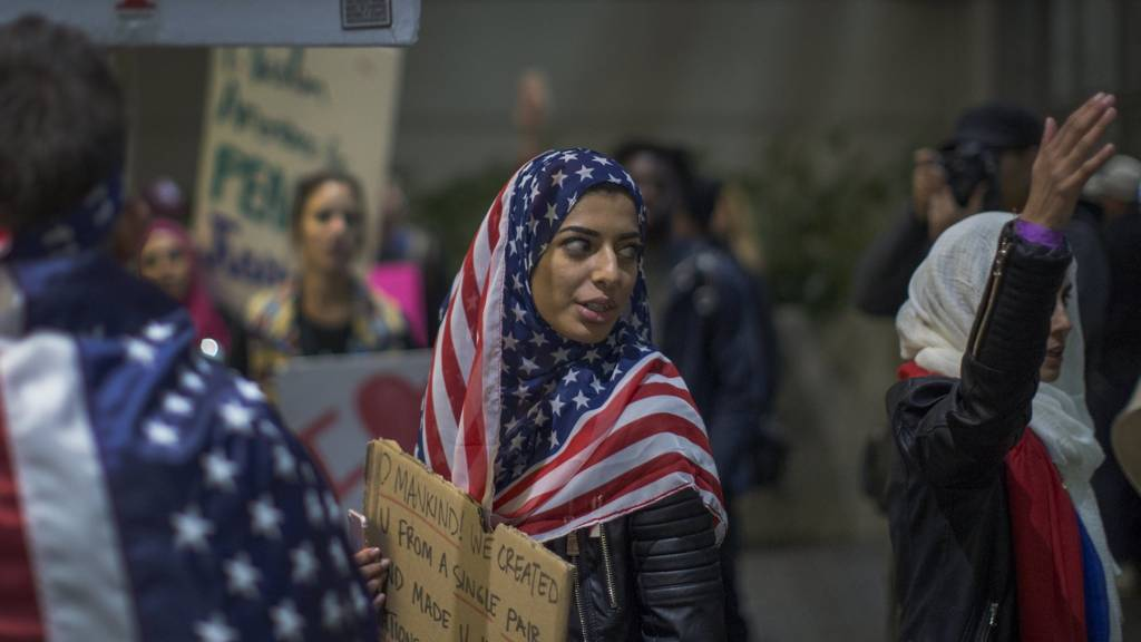 Demonstrators march against the last travel ban in Los Angeles, California, on 4 February 2017