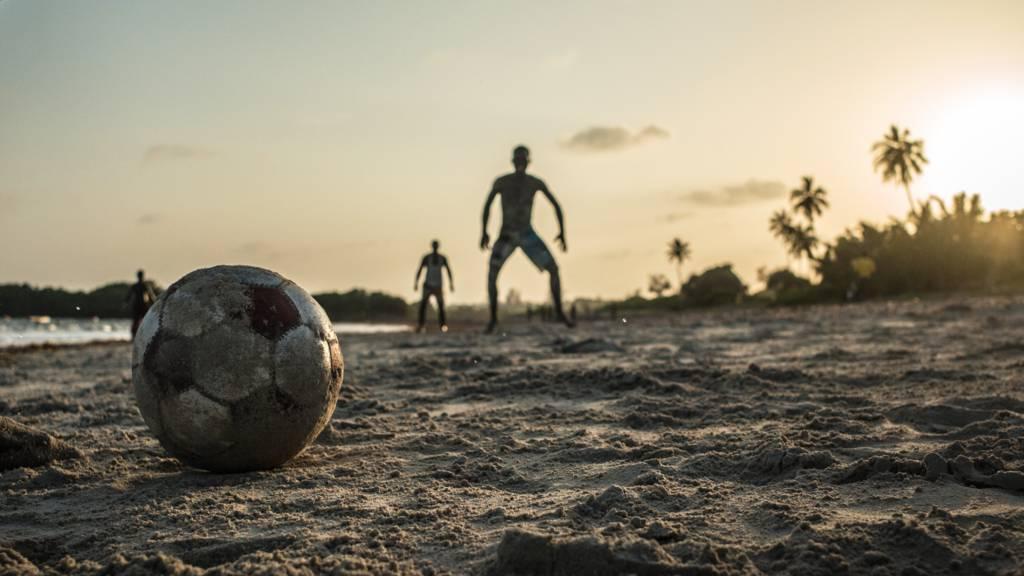 A football on a beach in Kenya