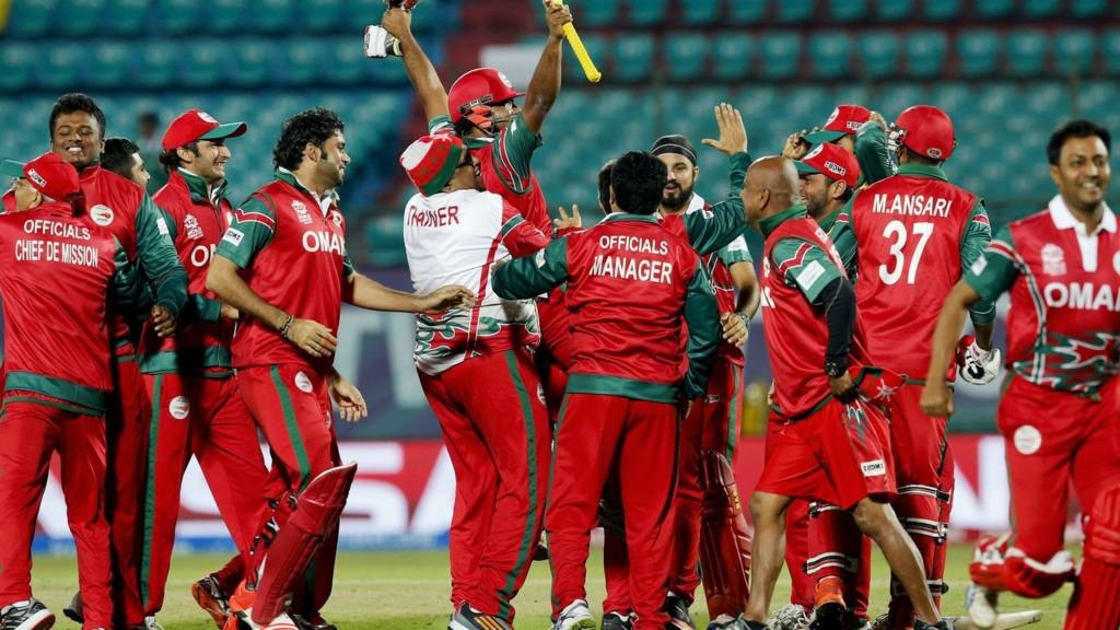 Oman's players celebrate