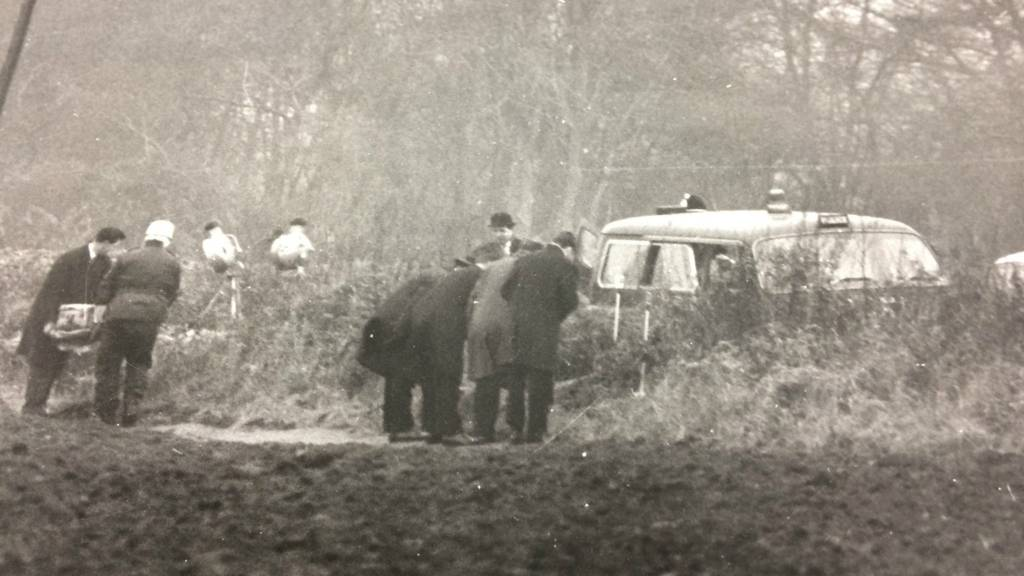 Police searching a field