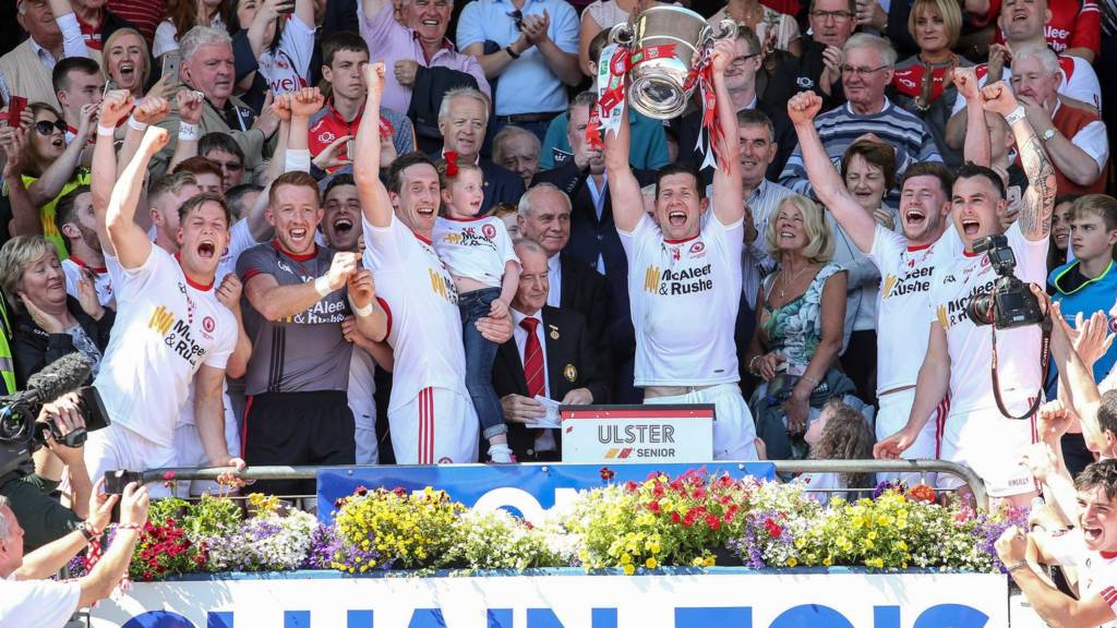 Tyrone players celebrate as captain Sean Cavanagh lifts the Anglo Celt Cup