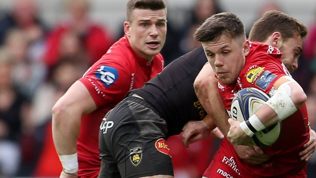 Scott Williams watches as Steff Evans is tackled