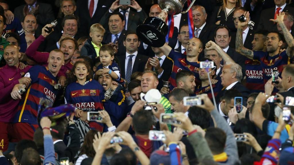 Andres Iniesta celebrates with the Copa Del Rey trophy