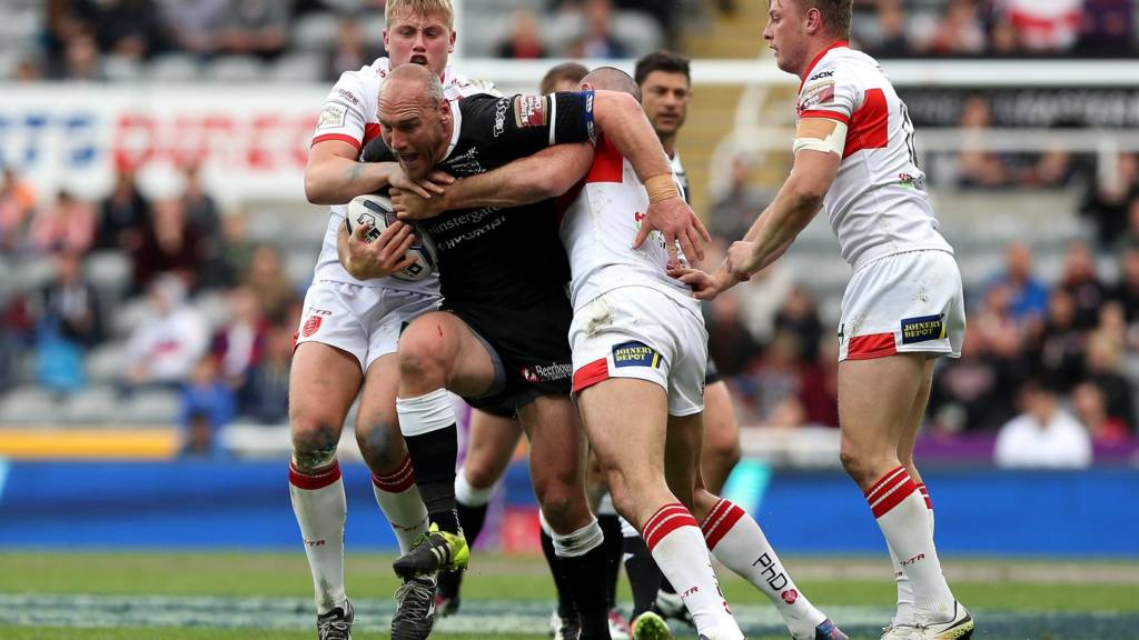 Gareth Ellis of Hull FC is tackled by Mitch Allgood
