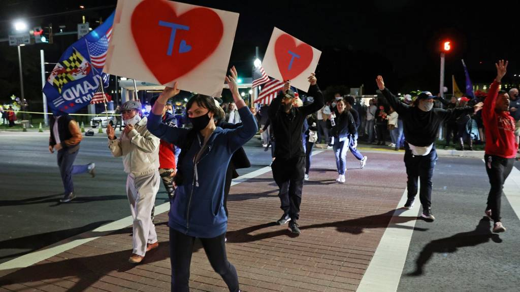Supporters rally at a vigil for U.S. President Donald Trump outside of Walter Reed National Military Medical Center, where he is being treated for coronavirus disease (COVID-19) in Bethesda, Maryland, U.S. October 3