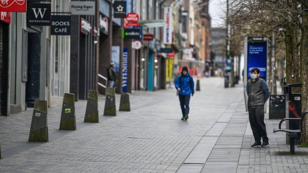 Men on empty street