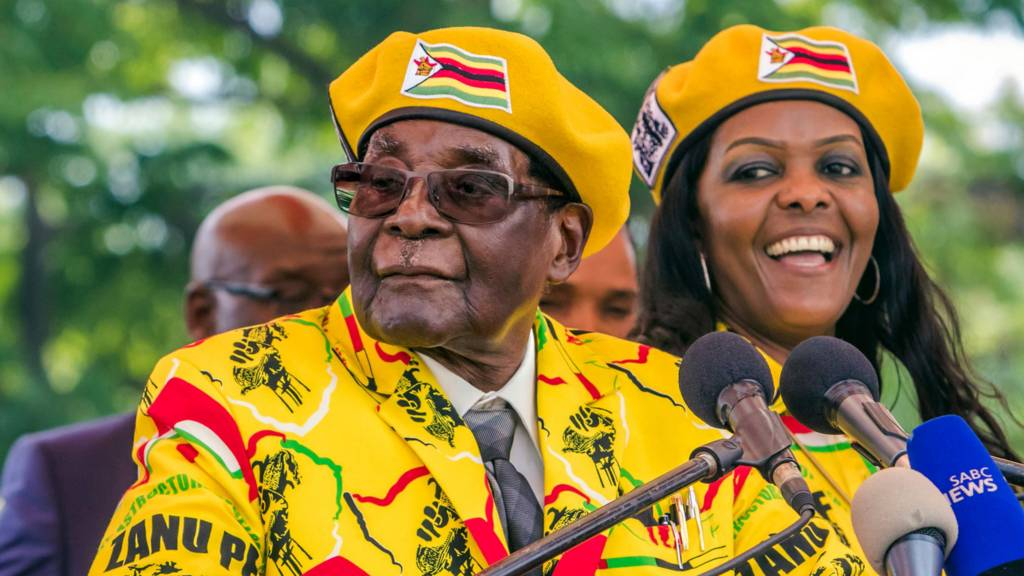 President Robert Mugabe (L) addressing party members and supporters gathered at his party headquarters to show support to Grace Mugabe (R) becoming the party's next Vice President after the dismissal of Emerson Mnangagwa. 8 November 2017
