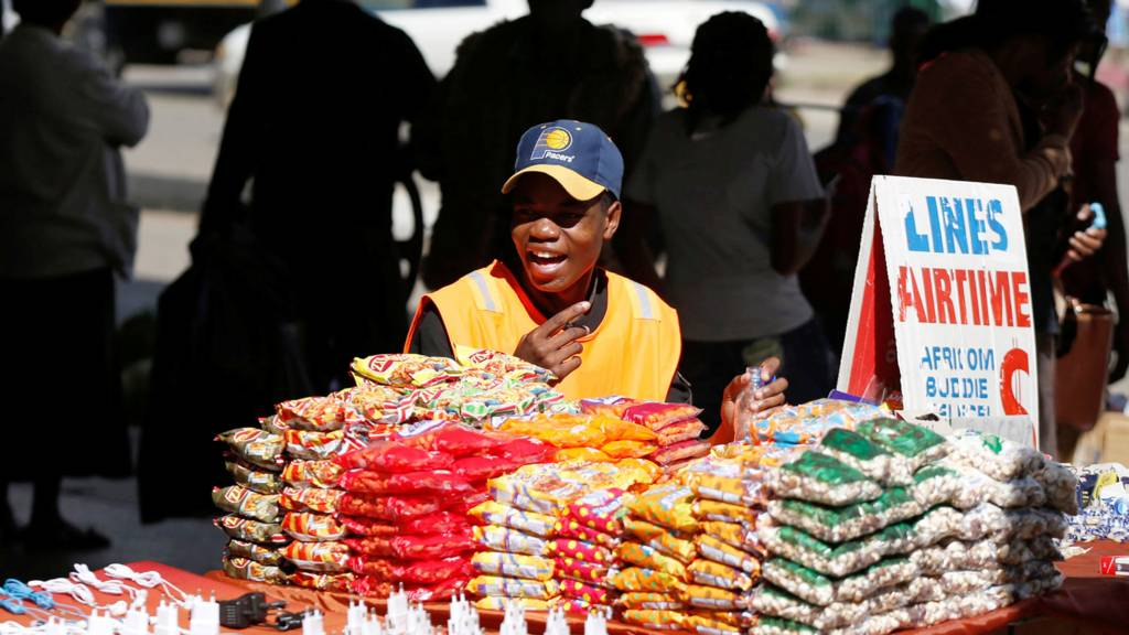 A trader waits for customers at his stall in Harare, Zimbabwe - 22 May 2018