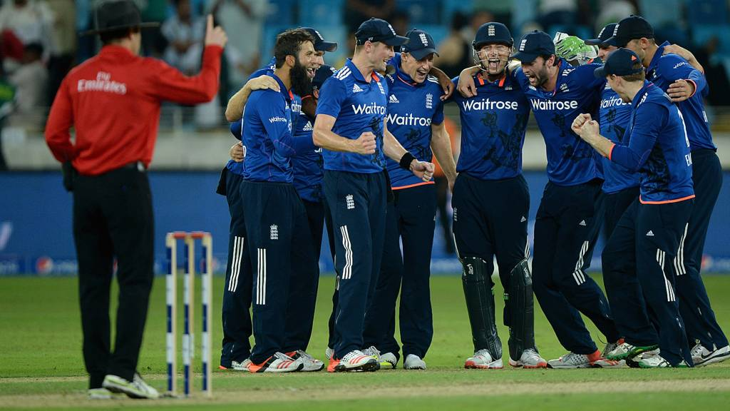 England celebrate taking the final wicket