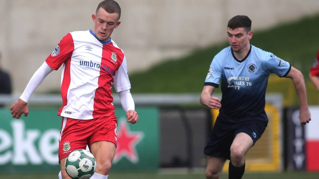Linfield's Michael O'Connor and Caoimhin Bonner of Institute