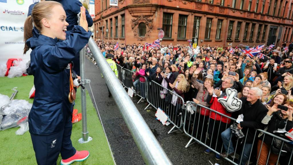 Ellie Simmonds waves to the crowd