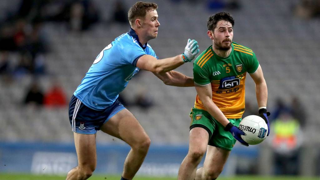 Donegal's Ryan McHugh is about to be challenged by Dublin's Paul Mannion