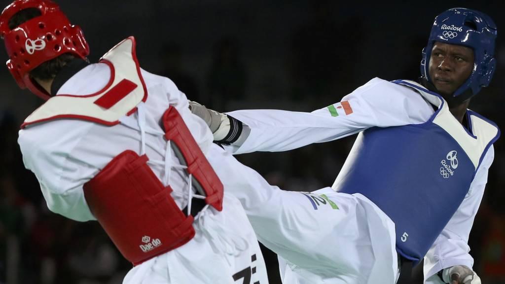 Issoufou Alfaga Abdoulrazak of Nigeria competes against Radik Isaev of Azerbaijan