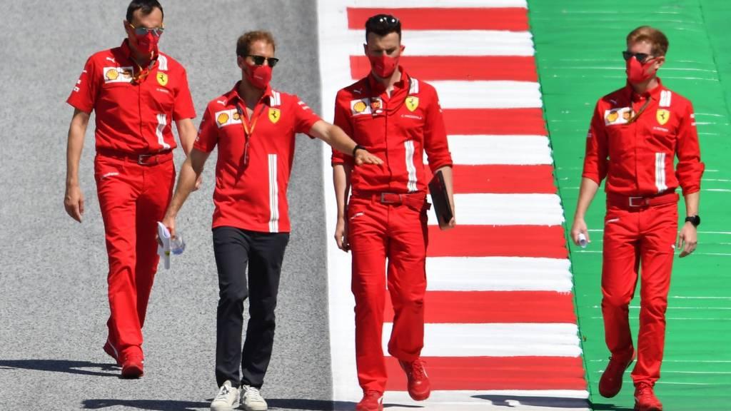 Sebastian Vettel and Ferrari engineers at the Red Bull Ring