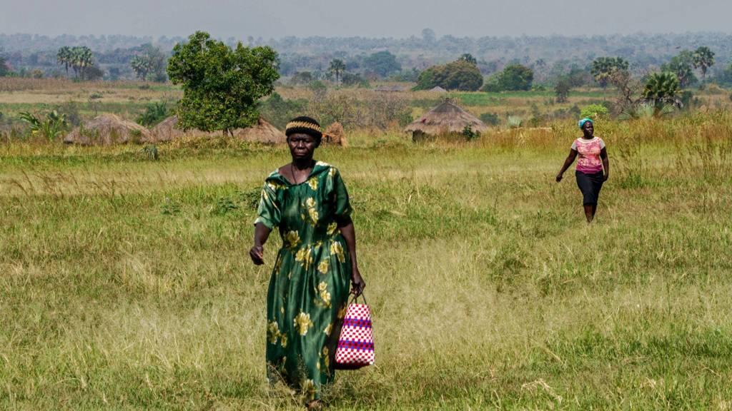 People in Gulu, northern Uganda, walking through a field
