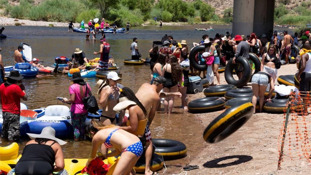People go tubing on Salt River amid the outbreak of the coronavirus disease (COVID-19) in Arizona, U.S., June 27, 2020